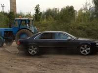 Audi S8 vs. tractor