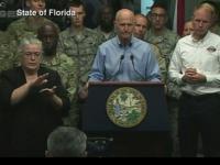 Konferencja gubernatora Florydy i jego tłumacz na język migowy