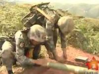 Chińscy żołnierze strzelający amunicją bez armaty